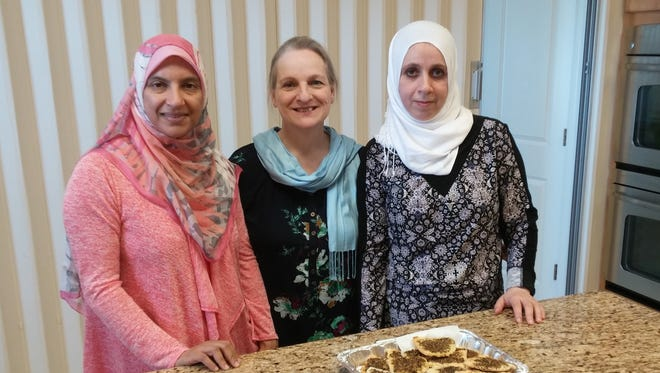 From Left: Mona Nemetallah, Helen Azarian, and Rana Alashi are three of the many ladies of the Islamic Society of Evansville who will be cooking dishes from all over the Muslim world for you to enjoy at the upcoming International Food Festival.