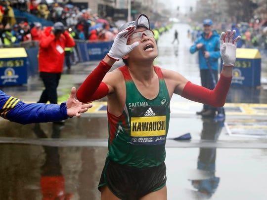 Yuki Kawauchi of Japan reacts after winning the men's division of the 2018 Boston Marathon.
