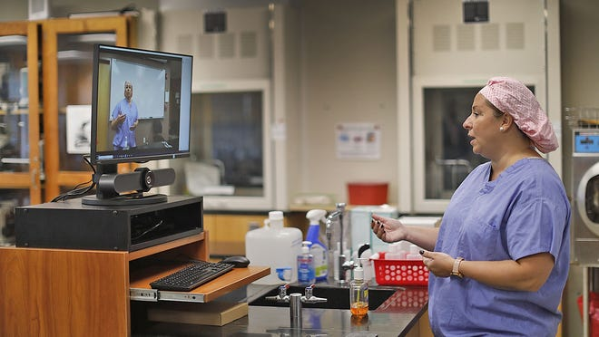 Instructor Nathalie Fulford conducts some of her surgical tech class via Zoom in an empty classroom at Quincy College on Thursday, Sept. 24, 2020.  Greg Derr/ The Patriot Ledger