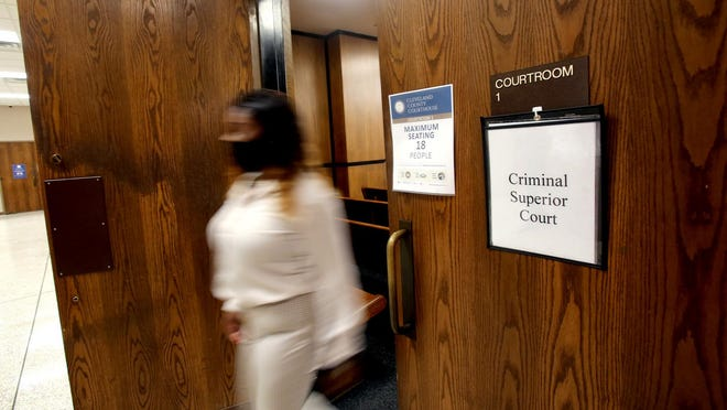 People exit courtroom one at the Cleveland County Courthouse.