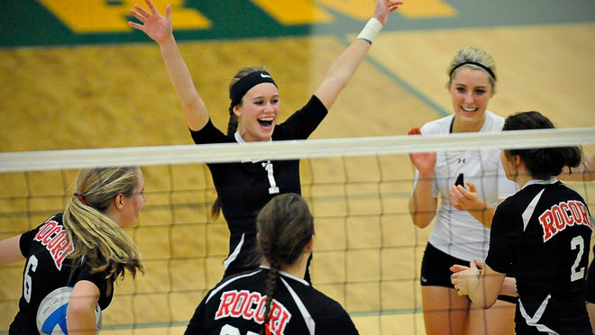 Rocori players celebrate a point against Cathedal in the section semi-finals Thursday.