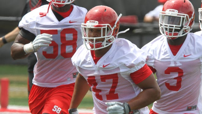 Isaiah Johnson (47) leads a crop of linebackers looking to replace three departed starters, including Steve Longa (3).