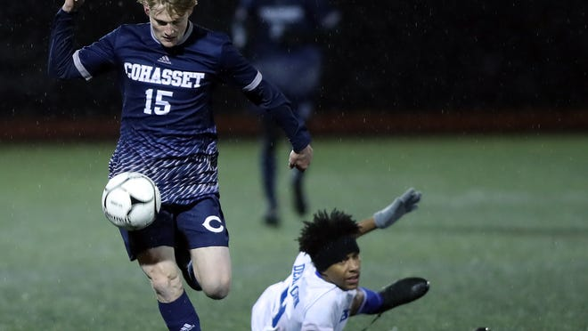 Cohasset's Whit Swartwood gathers in the ball while going on the attack in first half action of the Division 4 state semifinal at Manning Field on Wednesday, Nov. 20, 2019.