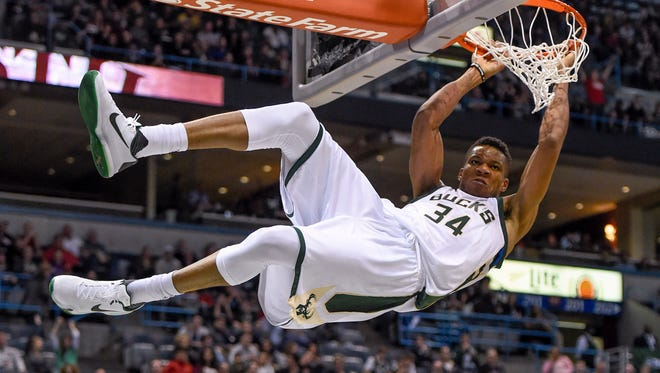 Milwaukee Bucks forward Giannis Antetokounmpo (34) hangs onto the rim after dunking for a basket against Sacramento earlier this year. Giannis has been a joy to watch for Bucks fans in 2016.