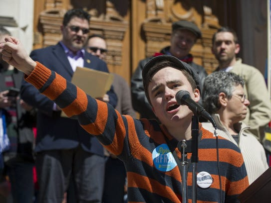 Jackson Blanchard, 18, of Indianapolis, leads the crowd