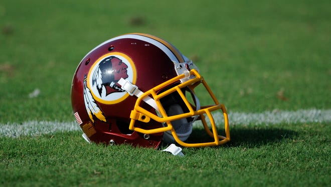 A Washington Redskins football helmet lies on the field during NFL football minicamp, Wednesday, June 18.