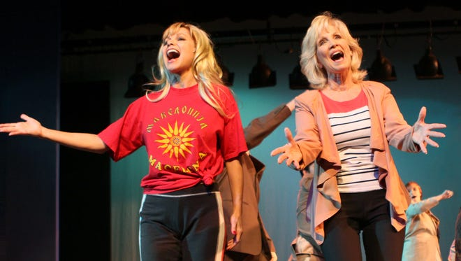 """Linnea Fayard Allen, left, playing Doralee Rhodes, and Brenda Rowan, in the role of Violet Newstead, rehearse the opening number of """"9 To 5: The Musical"""" at Strauss Theatre Center. The show opens Friday."""