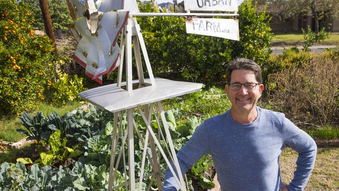Greg Peterson, owner of The Urban Farm in Phoenix, stands in his garden July 10, 2017. He sells and educates people about growing citrus trees in the Valley.