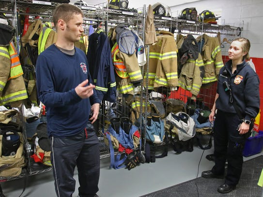 Tyler Williams talks with emergency medical technician Kelly Monahan as the two work a shift at the Hartland Fire Department on April 12.