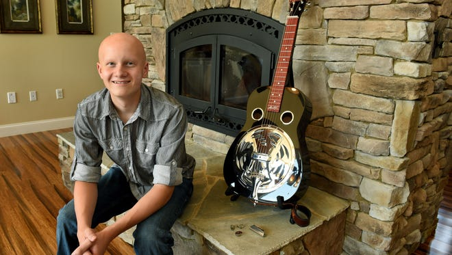 Duncan Stitt, a 13-year-old dobro-player who recently became the youngest person to win an award at ColoradoÕs RockyGrass festival, in his home in East Knox County Tuesday, Aug. 29, 2017.