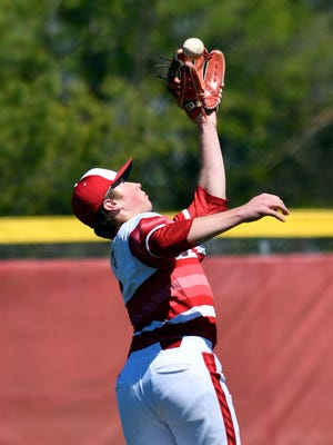 Jeffersonville's Bailey Falkenstein pulls in a pop fly during their game against Austin at Jeffersonville High School, Saturday, April. 8, 2017 in Jeffersonville, Indiana