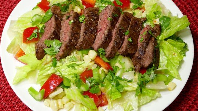 Jerk Steak Salad combines spicy tender meat with cool salad greens.