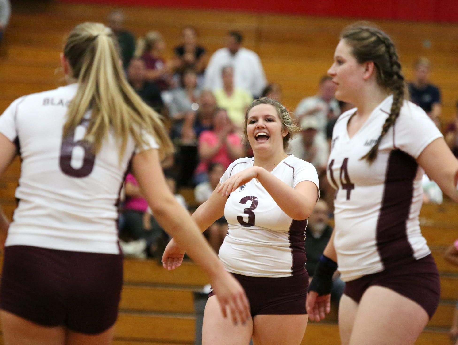 La Quinta's Jolie Samuelson, center, celebrates during the game against Palm Springs High in Palm Springs on Tuesday.