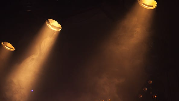 Scenic spot lights with bright beams in smoke, stage