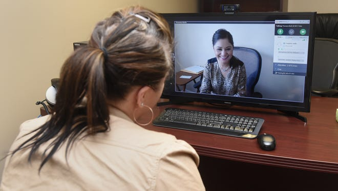 Autumn Nettles, RN, left, talks to Praveena Barlin, CNP, to demonstrate a telemedicine call Wednesday at Scioto Paint Valley Mental Health Center.