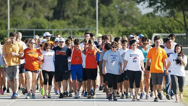 A long-time supporter of the Estero High cross country and track programs, Missy Mastroianni, far left, orange shirt, joined the Estero running community for a 2016 ceremony to remember Jeff Sommer, who died on May 2, 2015, in Jacksonville during the state track and field championships. Son Richard in on her left. Mastroianni has continued a scholarship for her son Mike, who died in 2003.