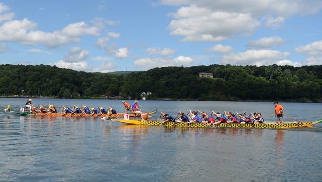 Dragons Alive (left) and Motley Crew race at the 5th Annual Dragon Boat Race and Festival on Saturday.