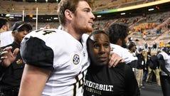 Vanderbilt Head Coach Derek Mason hugs Vanderbilt quarterback