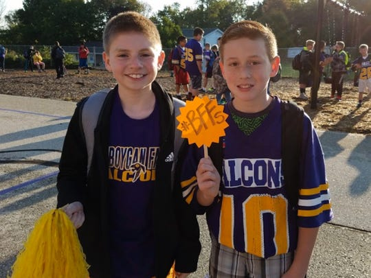 Two Sheboygan Falls boys pose on the first day of school at Sheboygan Falls, Wis.