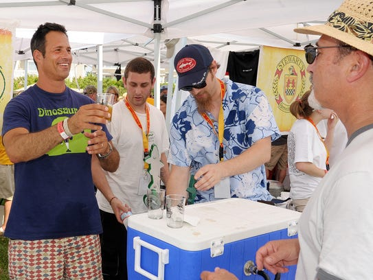 Dogfish Head founder Sam Calagione (left) serves up