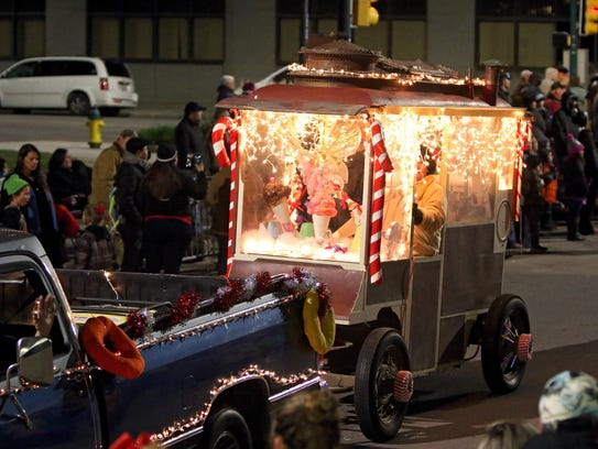 A 1913 Cretors and Company Popcorn Wagon is pulled along Eighth Street during the 2015 City Lights Parade in downtown Wichita Falls.