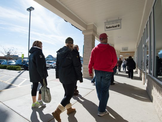 Shoppers at Tanger Outlets Surfside location in Rehoboth.