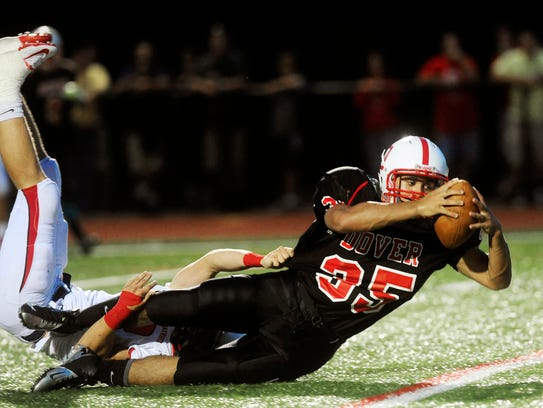 Dover's Isaiah Green is brought down by a Red Land
