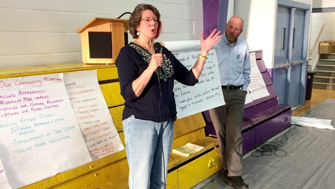 Debbie Gabse of Boulder talks Monday about suggestions her study group made regarding the town's future in the wake of the Montana Developmental Center closing as Dan Clark looks on at Jefferson High School in Boulder.