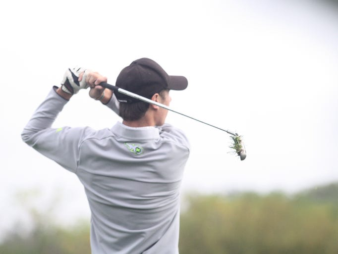 Mason's Cameron Madden hits an iron shot at the Division