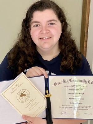 Great Bay Community College graduate Makayla Herget, who completed her associate in science criminal justice this spring shares a photo with her diploma, which was sent to all graduates prior to the virtual commencement ceremony scheduled for June 20.