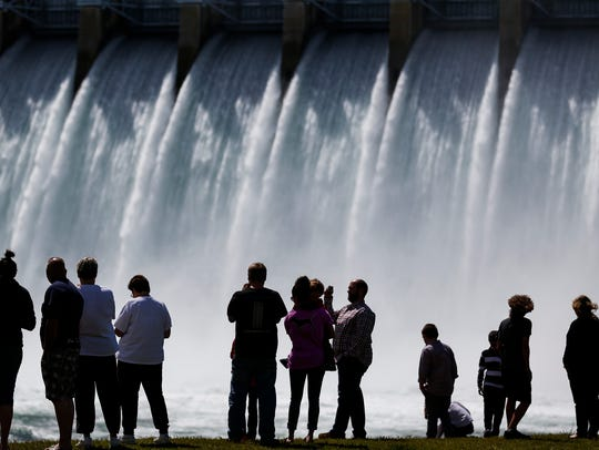 People watch and take photos of Table Rock Dam as it releases 50,000 CFS of water into Lake Taneycomo on Sunday, April 30, 2017.