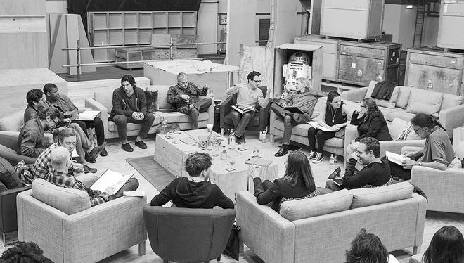 """""""Star Wars: Episode VII"""" director J.J. Abrams, center, meets with his cast, including John Boyega, Daisy Ridley, Adam Driver, Oscar Isaac, Andy Serkis, Domhnall Gleeson, Max von Sydow,  Harrison Ford, Carrie Fisher, Mark Hamill, Anthony Daniels, Peter Mayhew and Kenny Baker."""