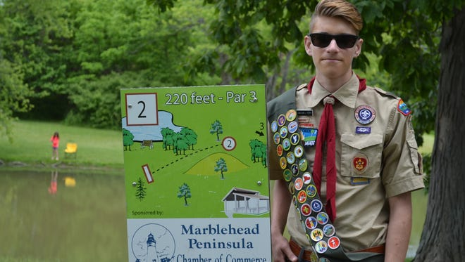Jonathan Perry made it a lot easier for disc golf players to find the back nine holes East Harbor State Park's course. He installed posts and signage at them as his Eagle Scout project. Prior to the completion of the project, players had to use maps to locate the holes.