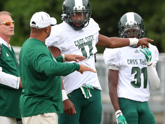 Cass Tech head coach Thomas Wilcher talks with Jalen Graham during action against Henry Ford High School on Friday, Sept. 7, 2018, at Henry Ford in Detroit. (Photo: Kirthmon F. Dozier/Detroit Free Press)