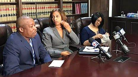 The family of Jakiel Jones sued the Stevens Brothers Funeral Home last July after a photo of her disfigured body ended up on social media as the funeral home was preparing it for her funeral. At left is her father, Jessie Jones, and her mother, Deanna Washington, is at right. Between them is their attorney, Nicole Hunt Jackson.