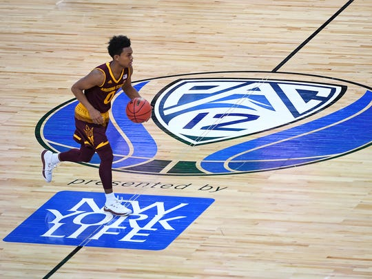 Arizona State's Tra Holder dribbles across mid-court