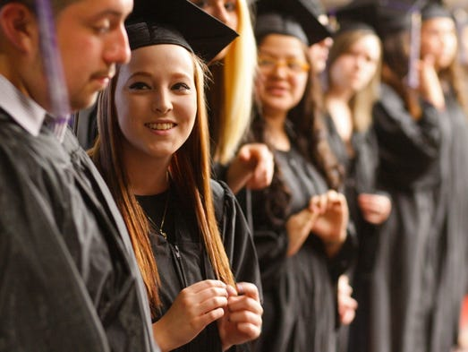 Graduating senior Julianna Voight (second from left) waits with her classmates for the start of the Early College High School and Roberts Teen Parent graduation at North Salem High on Thursday, June 5, 2014.