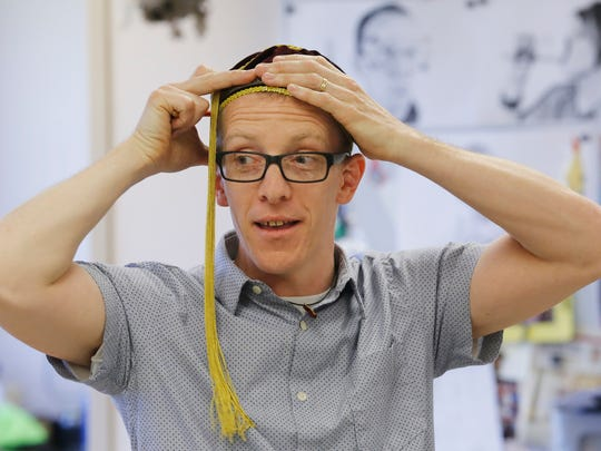 """""""It's not really about what I'm doing,"""" says Phil Pusey, donning a whimsical hat during a recent classroom discussion at West Lafayette Jr. High School. """"It's, 'What do you have in you?' """""""