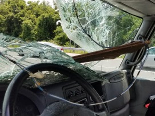 A box truck was damaged and its driver injured after