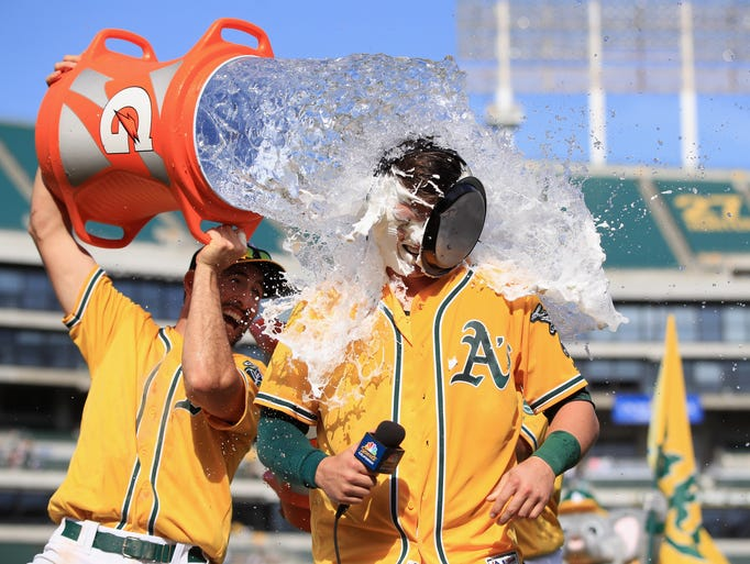 Ryon Healy of the Oakland Athletics is covered in water
