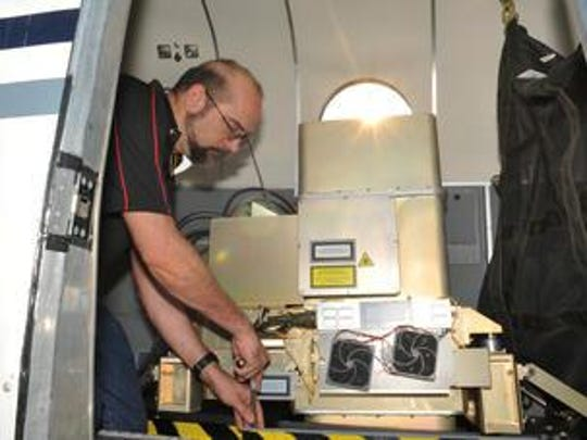 Harris Corp. chief operator Frank Pyle, works with the company's IntelliEarth Geiger Mode LiDAR on a King Air B200 at Baer Air at Orlando Melbourne International Airport. The technology, available commercially for about a year now, enables higher quality imagery taken from above and does it much faster and more efficiently than existing technology.