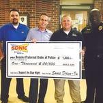 From left to right, Sonic area supervisor Bobby Triplet, Sonic area owner  Paul Reiser, Bossier FOP President Chris Davis and Bossier FOP Vice President Tyrone Warren.