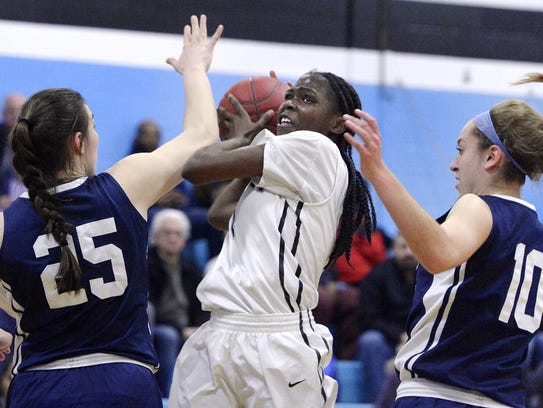 Bishop Kearney's Lytoya Baker tries to split the defense