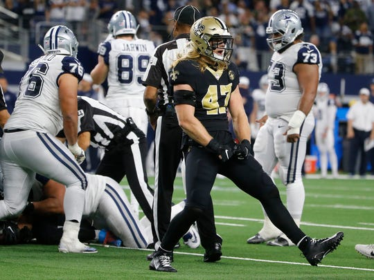 New Orleans Saints middle linebacker Alex Anzalone (47) celebrates after Dallas Cowboys quarterback Dak Prescott fumbles and New Orleans recovered the ball during the second half of an NFL football game, in Arlington, Texas, Thursday, Nov. 29, 2018. (AP Photo/Michael Ainsworth)