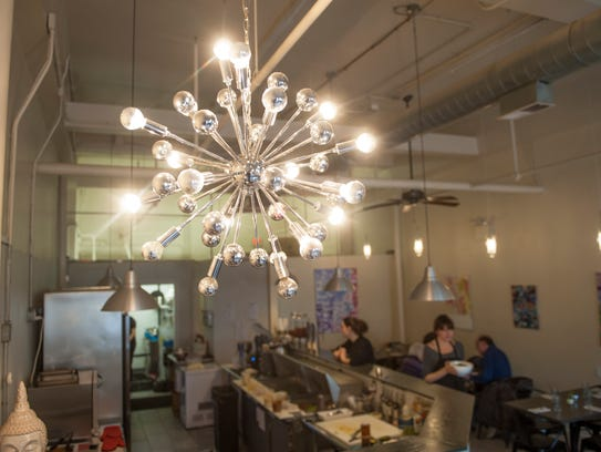 The interior of Leaf is bright and airy and decorated with the owner's artwork.