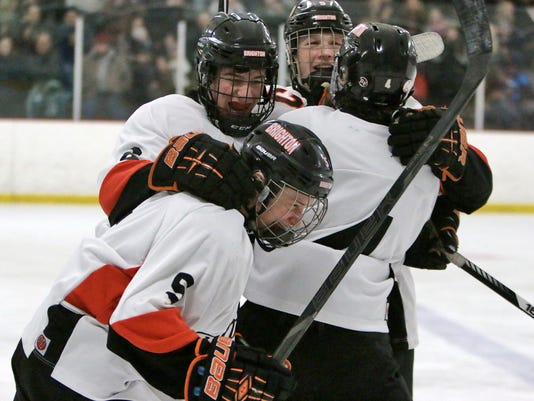 Samuel Brennan is swarmed by team mates after scoring the games only goal to.jpg