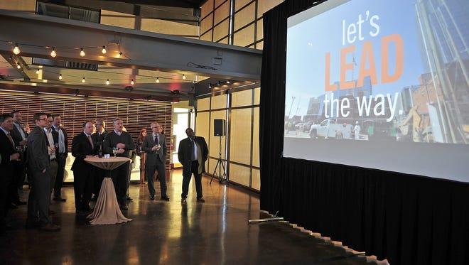 People watch a video of Nashville Area Chamber of Commerce's regional economic development successes at The Bridge Building in Nashville, Tenn., Thursday, Feb. 19, 2015.