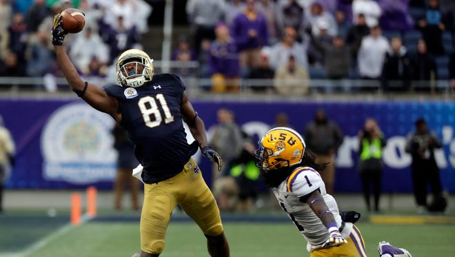 Notre Dame wide receiver Miles Boykin (81) makes a one handed catch for a 55-yard game winning touchdown during the second half of the Citrus Bowl, Jan. 1, 2018.
