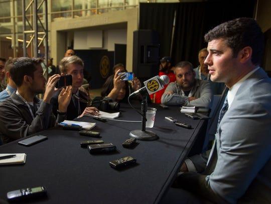 Auburn quarterback Jarrett Stidham talks to the press
