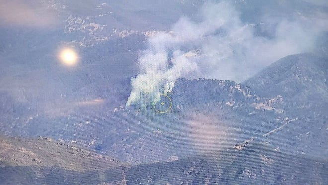 Photo from aircraft shows fire burning near Rock Front Ranch